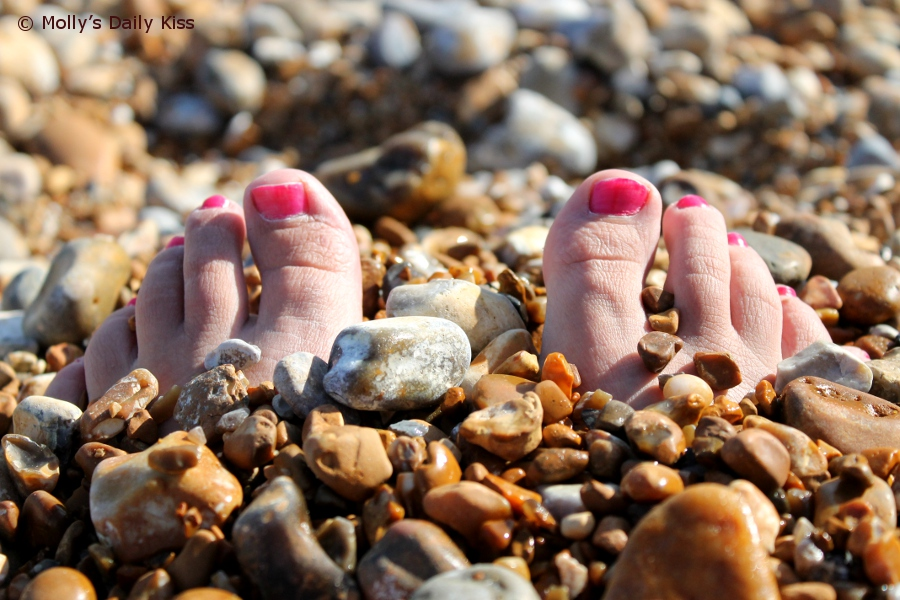Toes buried in the beach