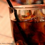 close up of a glass of ice and coke