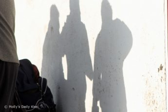 Shadow of 3 men