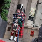 man in highland dress playing the bagpipes in edinburgh