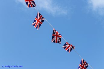 Union Jack flags against a blue sky