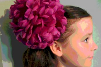 Young girl with flower in hair