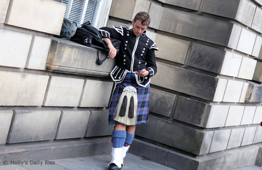 scottish piper on mobile phone