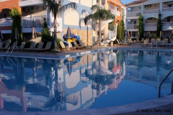 Reflection of Planos Bay Hotel in swimming pool