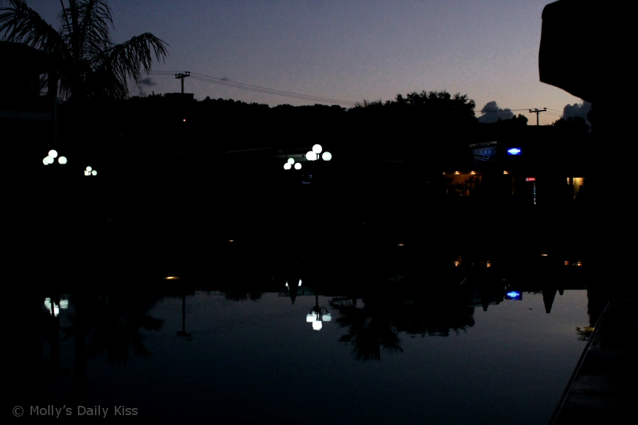 Night lights reflected in water