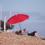 Red umbrella on Hastings beach
