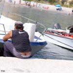 Greek man tending to his boat