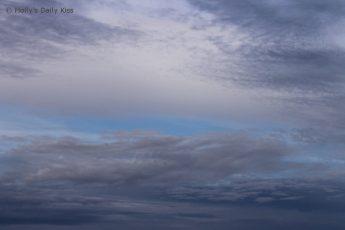 dark clouds against a blue sky