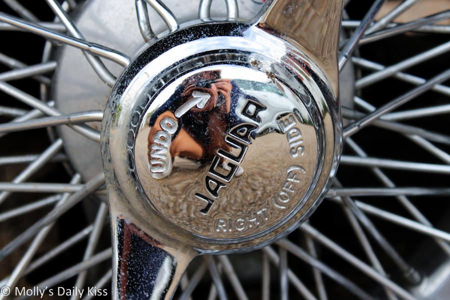 Self portrait in Jaguar hubcap