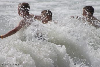 Boys playing in the surf on Hastings beach