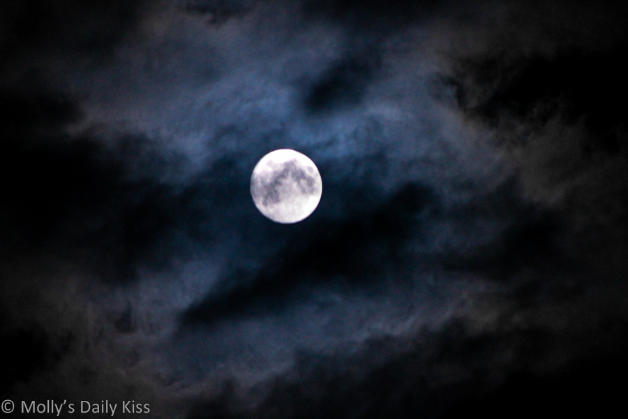 Clouds over the moon