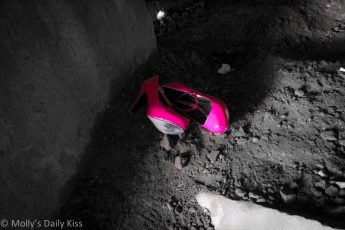 Pink shoes left in the dirty