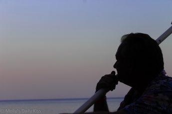 Thoughtful man at sunset
