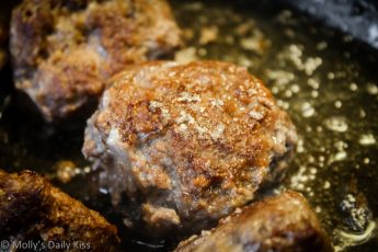 Meatballs sizzling in the pan