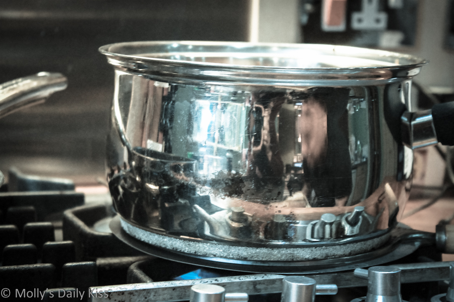 reflection of the kitchen in a saucepan