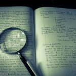 written words on a page with magnifying glass