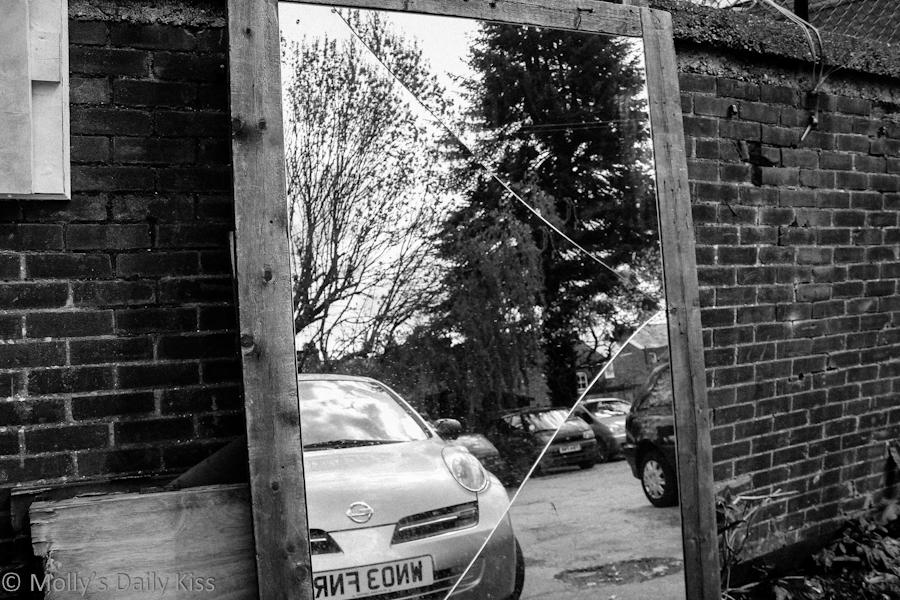 Broken mirror outside the junk yard