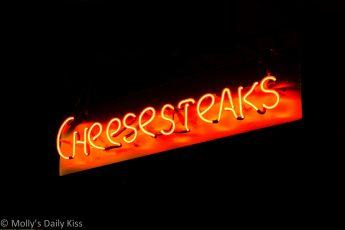 Cheesesteak neon sign in Reading Terminal Market