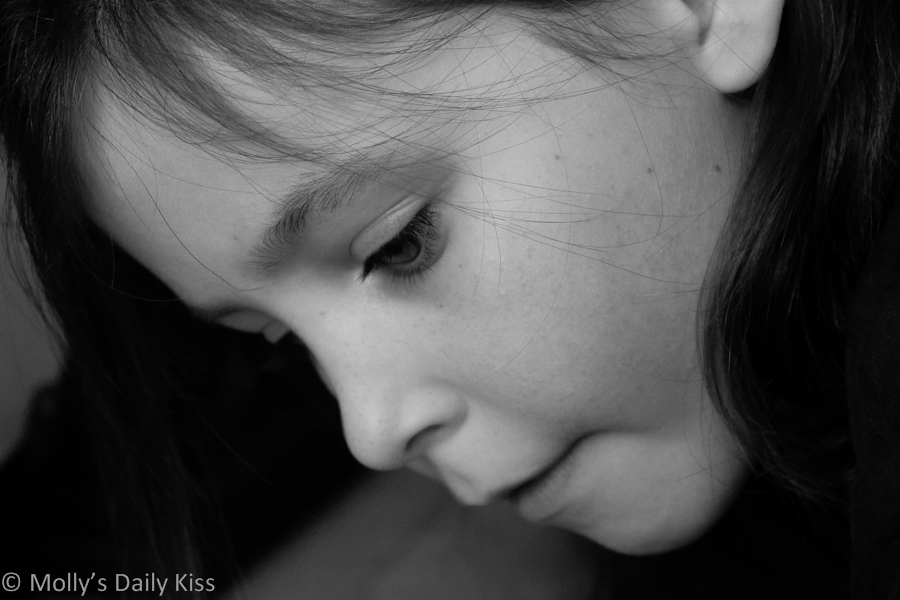 child deep in concentration, black and white photograph