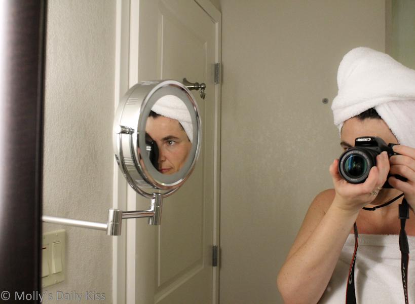Self portrait in hotel mirror
