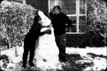 Friends building a snowman