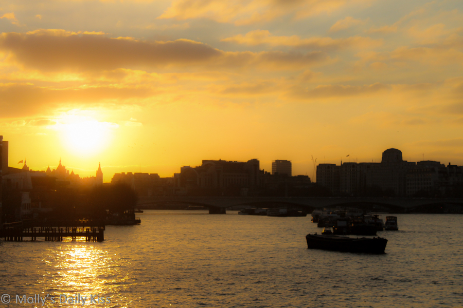 Sunset over the Thames in London skyline