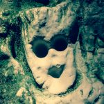Spooky face carved in to cave wall
