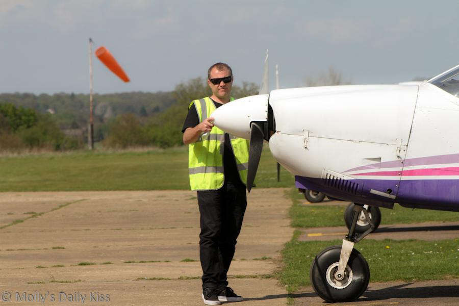 Pilot checking his plane