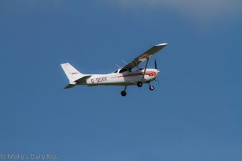 Small aircraft taking off into blue sky
