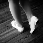 Young girl dancing in tap shoes black and white