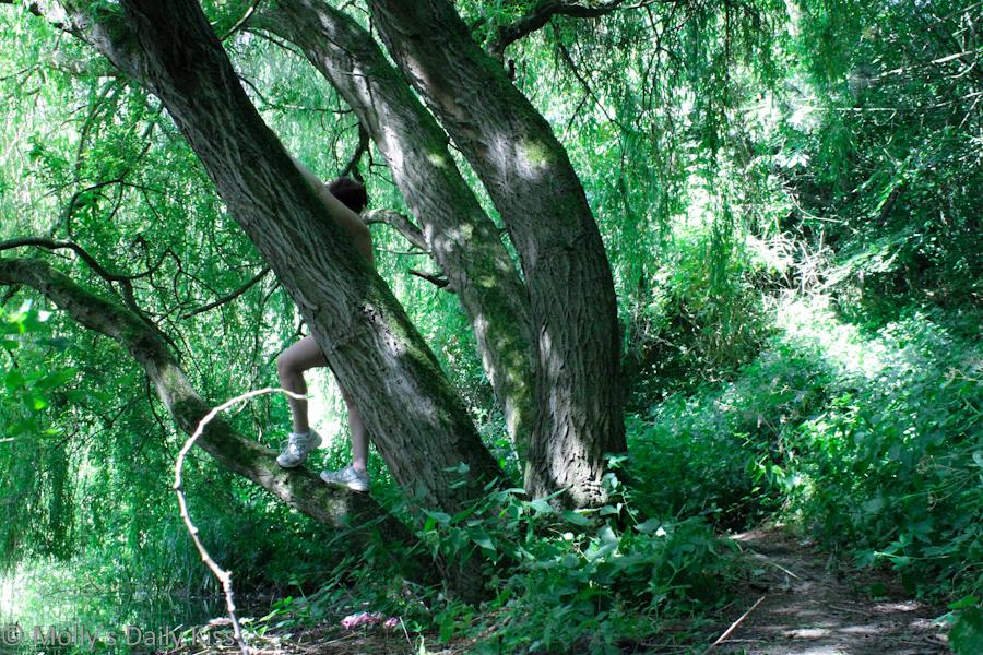 Naked in woodland summer glade