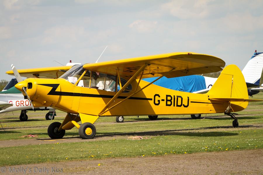 Yellow small single seat plane