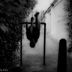 Girl upside down on railings