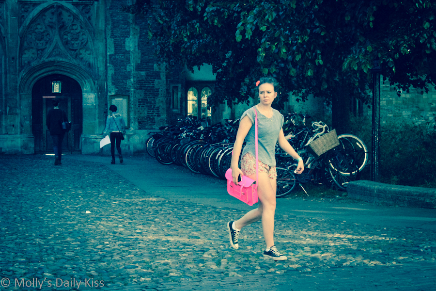 Fashionable girl with pink satchel
