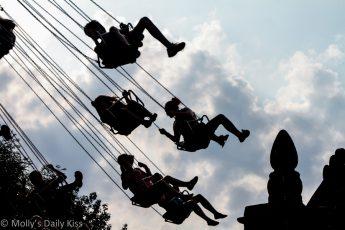 Fair grpund swing against the clouds