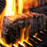 Steak on the grill at the Tiki Bar