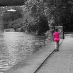 Young girl walking by the river