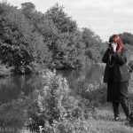 Red head woman photographer