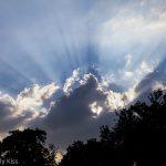 Sun rays bursting through storm clouds