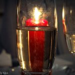 Candle through champagne glass