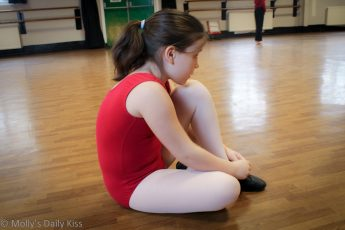 Girl getting ready for her dance class