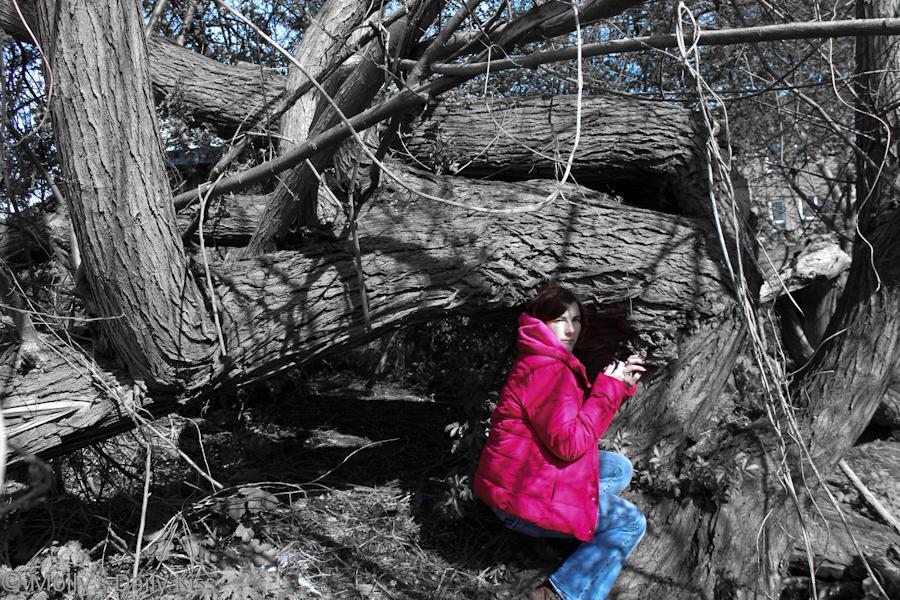 Self portrait by fallen tree in the woods