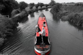 Red Canal boat on the river Stort