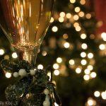 Wine and mistletoe with christmas tree