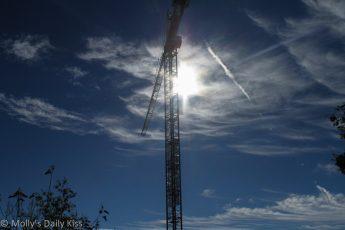 Construction crane with sun burst