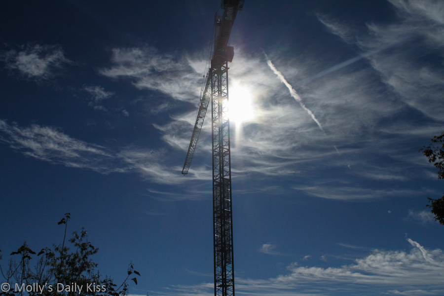 Construction crane with sun burst