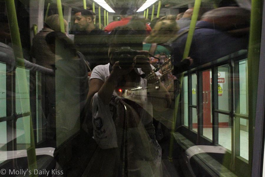 Self portrait in window of train