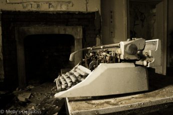 Old typewriter in abandoned house
