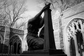 Kneeling woman statue