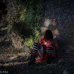 Woman in stripe socks praying
